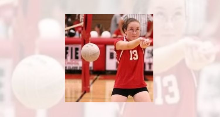 Girl playing volleyball misses the ball